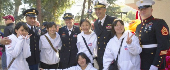 Japanese exchange students pose with United States military personnel.