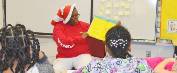 : A Honda associate reads to a class of elementary school students.