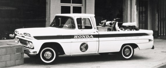 Antique Honda truck with a motorcycle in back