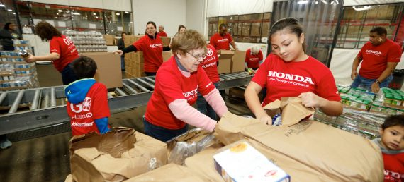 Associates Help Sort Holiday Food Drive Items