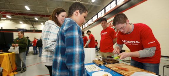 Associates Help Students Build Cars – From Food!